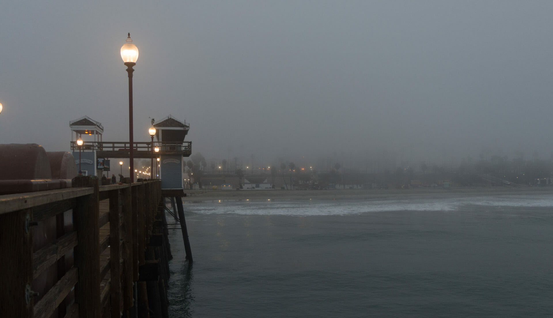 Oceanside Pier looking back toward shore on a foggy morning