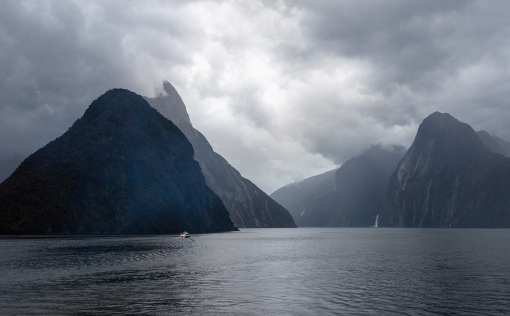 Milford Sound - a small boat cruises the sound