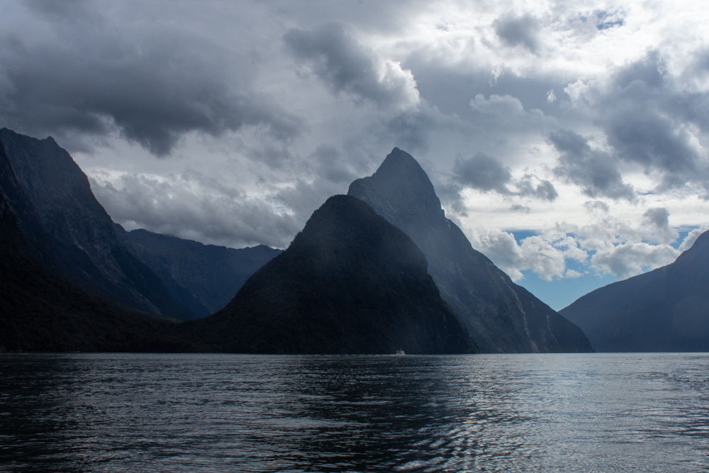 Milford Sound surrounded by towering peaks