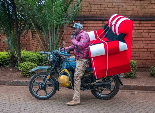 A Boda Boda (motorbike taxi) carrying a couch